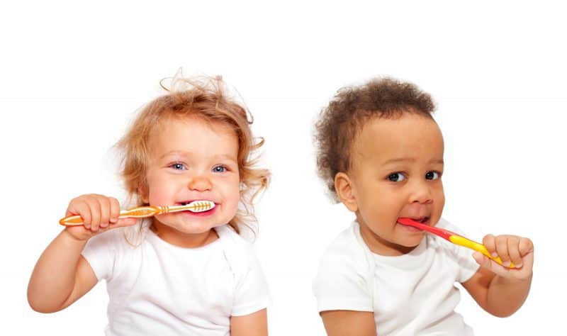 baby toddlers brushing teeth